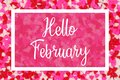 Hello February greeting card with white text over a candy heart background Royalty Free Stock Photo