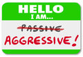 Hello i am aggressive vs passive action or inaction attitude a green nametag with the words and the word crossed out to illustrate Royalty Free Stock Photos