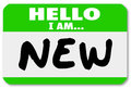 Hello i am new nametag sticker rookie trainee a green with the words for a staff hire newbie beginner or apprentice Royalty Free Stock Image