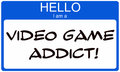 Hello i am a video game addict written on blue and white name tag sticker Stock Image
