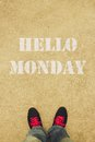 Hello monday text is painted on the ground in front of the feet Royalty Free Stock Images