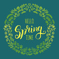 Hello spring time lettering inspirational typography banner. Vector handwritten text in round floral frame.