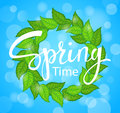 Hello Spring time wreath with green fresh leaves on blue background