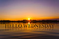 `HELLO WEDNESDAY ` with sunset water , twilight time Royalty Free Stock Photo