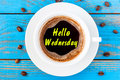Hello Wednesday - text on morning cup of coffee. Top view, inspiration and motivate message Royalty Free Stock Photo