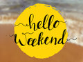 Hello weekend lettering on sea view. Inspirational quote on beach background Royalty Free Stock Photo