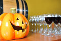 Helloween party pumpkin and wine glasses Stock Image