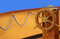 Helm wheel and compass colorful deck with rope Stock Images