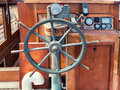 Helm of wooden boat or steering wheel an old ship Royalty Free Stock Image
