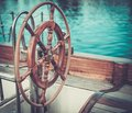 Helm on a yacht vintage wooden Stock Photo