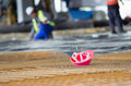 Helmet on reinforcement mesh red standing upside down at building site Royalty Free Stock Image