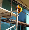 Helmet on scaffold yellow protective left the Royalty Free Stock Photo