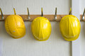 Helmets on coat hangers two hanging a construction place Stock Photography