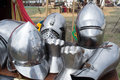Helmets and pieces of medieval armor on display Stock Photos