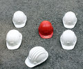 Helmets a red and five white Stock Image