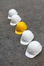 Helmets row of white and yellow Royalty Free Stock Photo