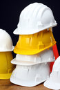 Helmets stack of white and yellow on black Stock Photo