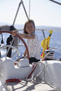 Helmsman steering sailing boat a young female a Royalty Free Stock Image