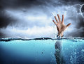 Help concept drowning and failure man's hand in sea Stock Photos