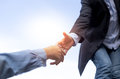 Help concept hand reaching out help someone with blue sky Royalty Free Stock Photo