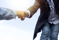 Help concept hand reaching out to help someone with sunlight Royalty Free Stock Photo