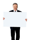 Help desk executive showing white billboard Royalty Free Stock Photo