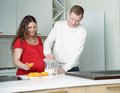 Help and devotion going through important time together young husband making healthy snack for his pregnant wife Royalty Free Stock Photography