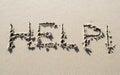 Help handwritten on sand beach written Royalty Free Stock Images