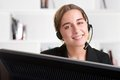 Help line corporate woman talking over her headset Stock Image