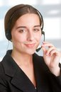 Help line corporate woman talking over her headset Royalty Free Stock Photography