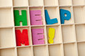 Help me wooden letter blocks forming the words Stock Image