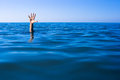 Help needed. Drowning man's hand in sea Royalty Free Stock Photo