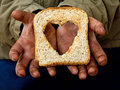 Help relief poverty and hunger with love Stock Photos