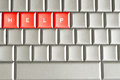 Help spelled on a keyboard word metallic Stock Photos