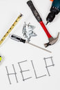 Help word formed with screws home improvement scene Stock Photos