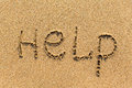 HELP - written manually on the texture of sea sand. Nature. Royalty Free Stock Photo