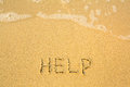 Help written in sand on beach texture soft wave of the sea nature Stock Images