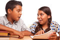 Helpful Hispanic Brother and Sister Having Fun Studying Stock Photo