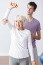 Helpful physical therapist young and older exercising woman Royalty Free Stock Photos