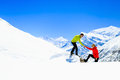 Helping hand couple hikers in mountains Royalty Free Stock Photo