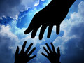 Helping hand sky background Royalty Free Stock Image