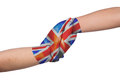 Helping hands of two children with United Kingdom flag painted