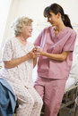 Helping nurse senior to walk woman Στοκ Φωτογραφίες