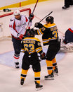 Helping a teammate bruins forward patrice bergeron comes to the aid of brad marchand against capitals defenseman roman hamrlik Stock Images