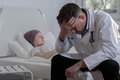 Helpless doctor and cancer child terminally ill Royalty Free Stock Photo