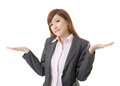 Helpless sign young business woman shrugs her shoulders on white background Stock Photo