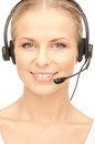 Helpline bright picture of friendly female operator Stock Photography