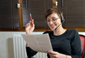 Helpline female customer support operator with headset and smiling Royalty Free Stock Photos