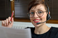 Helpline female customer support operator with headset and smiling Stock Images