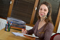 Helpline female customer support operator with headset and smiling Royalty Free Stock Image